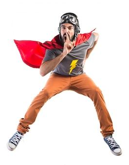 Super-herói fazendo o gesto de silêncio