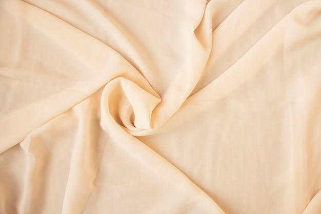 Superfície abstrata de tecido de seda de luxo, dobras onduladas de fundo de textura de seda de grunge