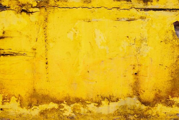 Superfície amarela suja de grunge ideal para fundos e textura
