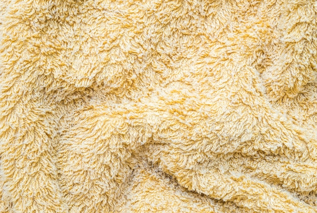 Superfície amarela tecido de guardanapo enrugado fundo texturizado