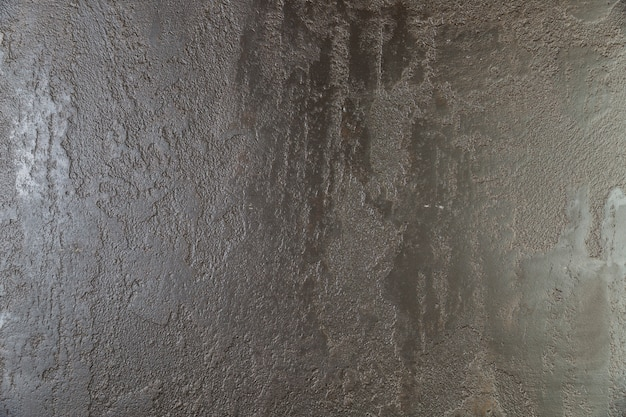 Superfície áspera pintada da parede de concreto