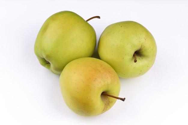 Superfície branca verde-amarela maçã dourada