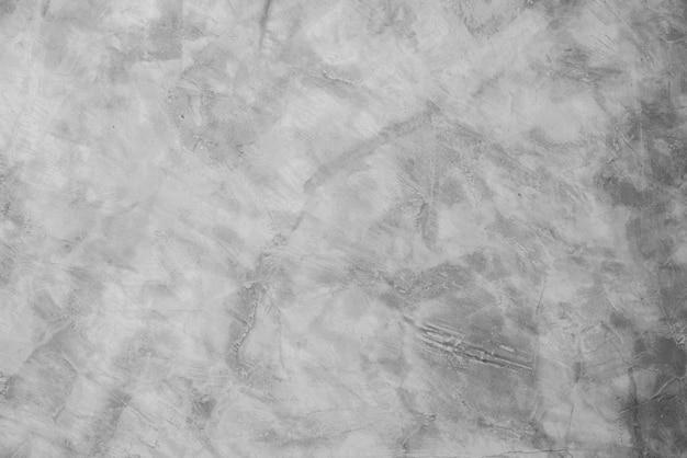 Superfície cinzenta do cimento para o fundo, muro de cimento.