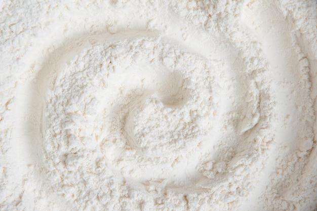 Superfície coberta com a farinha de trigo como uma superfície