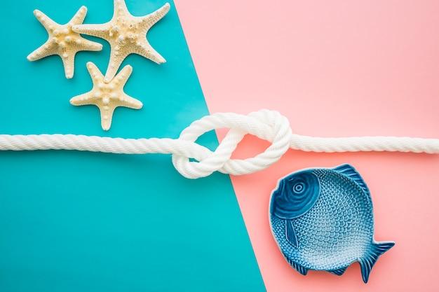 Superfície colorida com peixe e estrela-do-mar para o verão