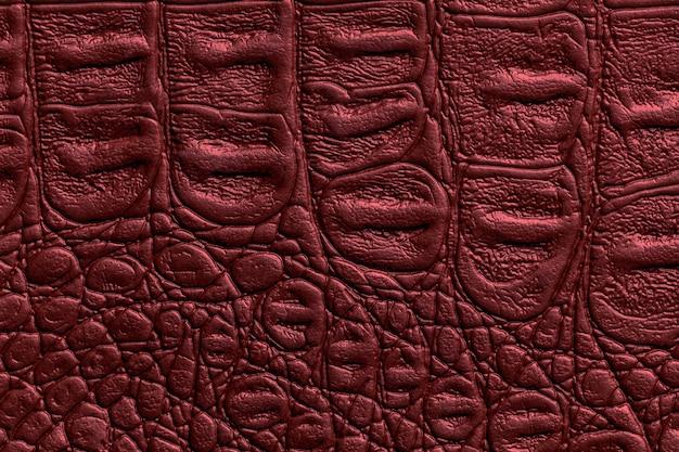 Superfície com textura de couro vermelho escuro