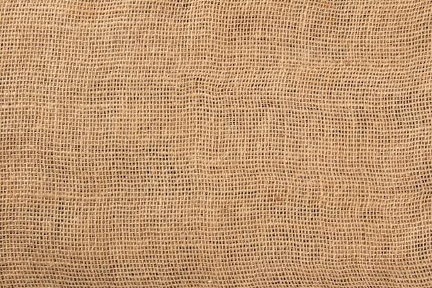 Superfície com textura de tecido de juta close-up.