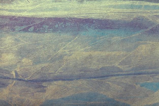 Superfície da arte abstrata em cores azul-escuras e douradas