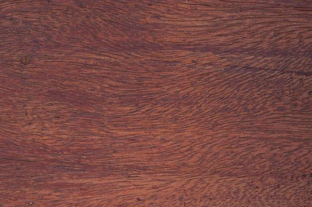 Superfície da mesa de madeira vermelha