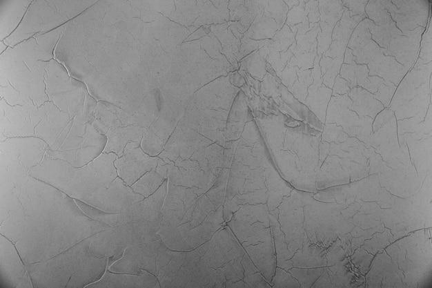 Superfície da parede de cimento com rachaduras