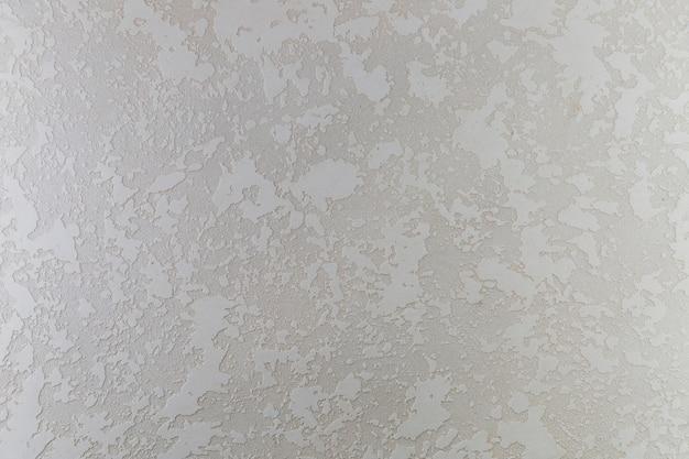 Superfície da parede de concreto com manchas ásperas