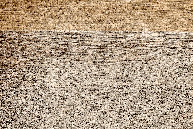 Superfície da parede de concreto quase pintada de ouro