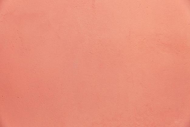 Superfície da parede de concreto rosa. fundo. espaço para texto.