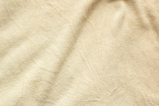 Superfície da textura do tecido de toalha perto do fundo