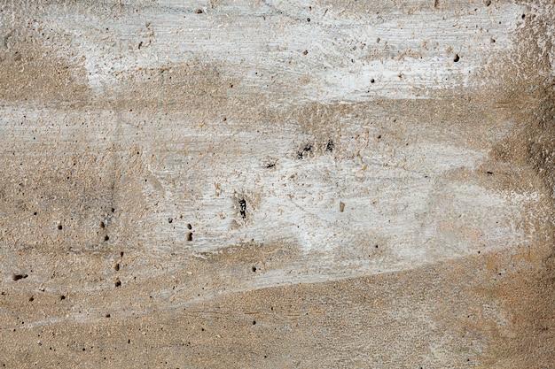 Superfície de cimento com pincel e pinceladas