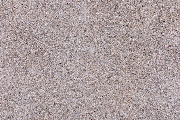 Superfície de cimento com seixos