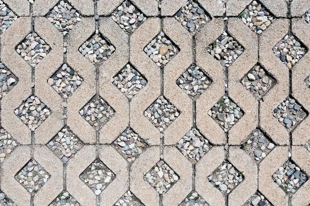 Superfície de cimento e seixo com padrão repetitivo de diamante para fundo ou textura