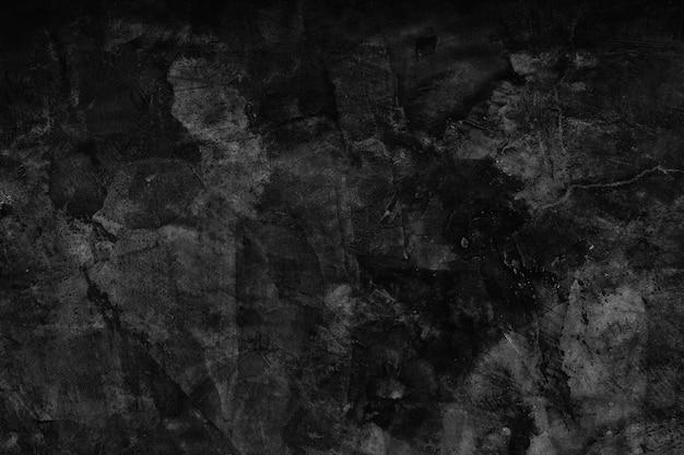 Superfície de cimento em tom escuro.