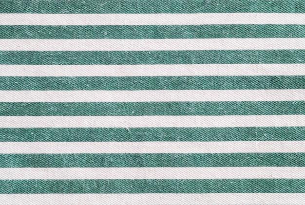 Superfície de closeup de tecido branco e verde saco texturizado fundo