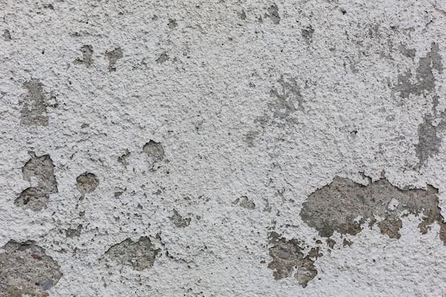 Superfície de concreto áspero com manchas abstraem textura de fundo