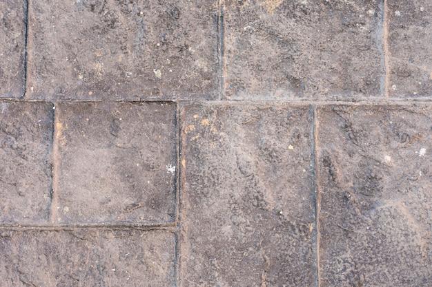 Superfície de concreto com pedras