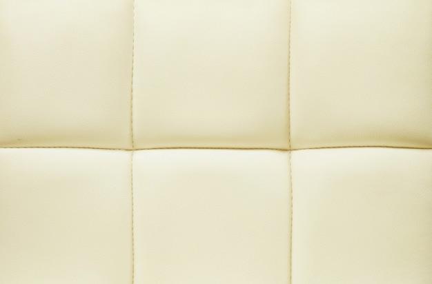 Superfície de couro amarelo de fundo de textura de sofá