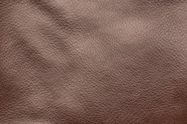 Superfície de couro liso marrom. fechar-se. fundo de textura.