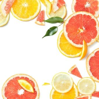 Superfície de frutas cítricas com fatias de laranja e toranja como símbolo de alimentação saudável e reforço do sistema imunológico com vitaminas naturais