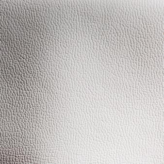 Superfície de fundo com textura de couro cinza claro extremamente close-up
