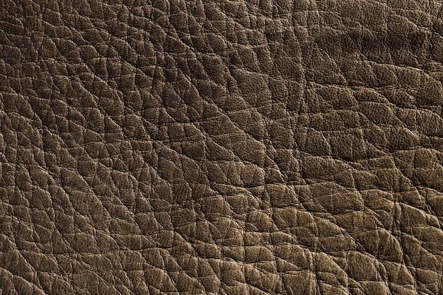 Superfície de fundo com textura de couro marrom escuro extremamente close-up