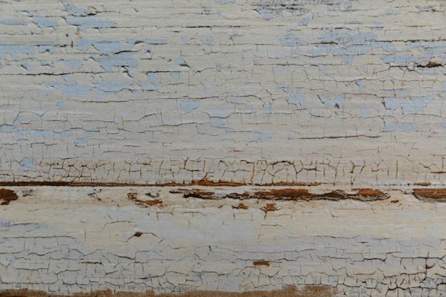 Superfície de fundo de textura de madeira branca pintada velha lascada