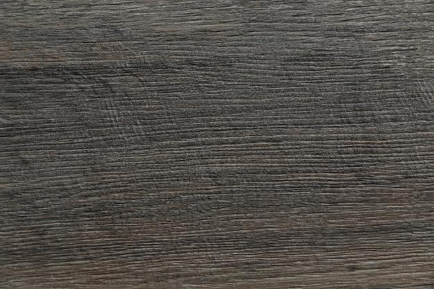 Superfície de fundo de textura de madeira cinza e marrom escuro com antigo padrão natural e linhas afiadas
