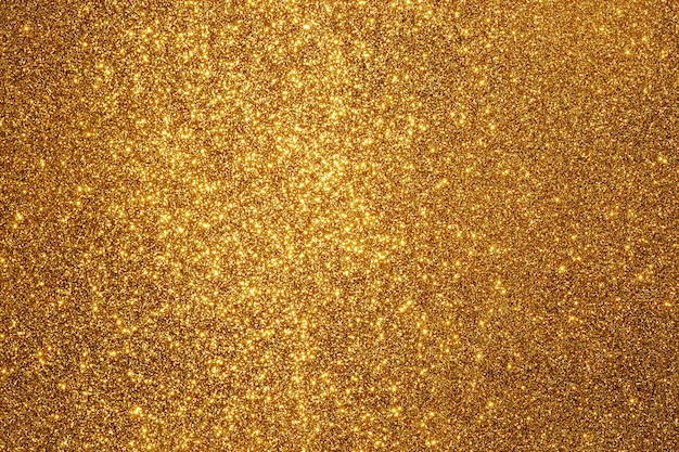 Superfície de glitter dourado