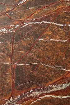 Superfície de granito marrom gráfico abstrato texturizado fundo liso de pedra, lugar para texto. superfície natural para decoração de interiores.