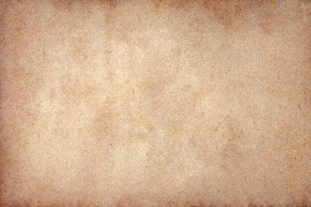 Superfície de grunge de papel pardo antigo. textura de cor de café líquido abstrata.