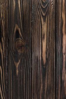 Superfície de madeira envelhecida com grãos e nós