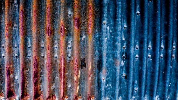 Superfície de metal com textura de ferrugem. fundo para o designer