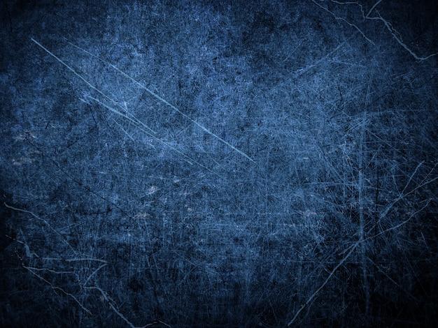 Superfície de metal riscada de estilo grunge azul escuro