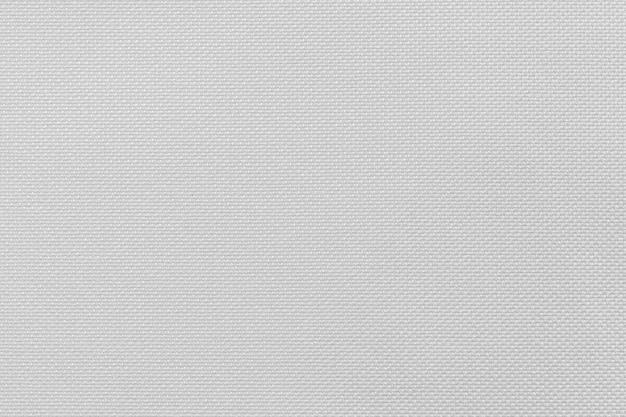 Superfície de microfibra branca ou fundo de textura de pano branco para o projeto em seu cenário de conceito de trabalho.