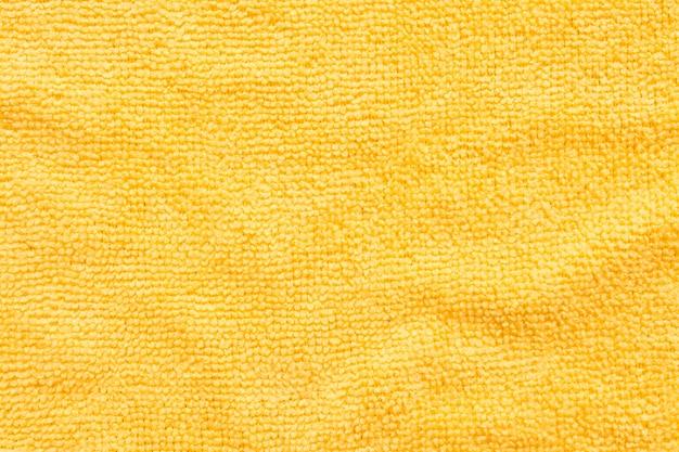 Superfície de pano de microfibra amarelo, fundo de padrão de têxteis de macro