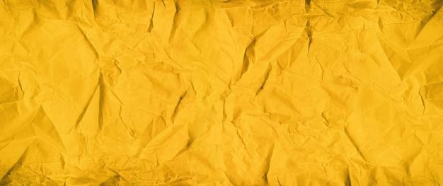 Superfície de papel amassado dourado