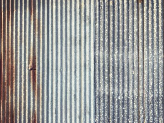 Superfície de parede de zinco velha casa de vedação, fundo e textura de zinco