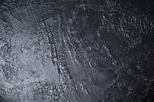 Superfície de pedra texturizada preta com lugar para texto