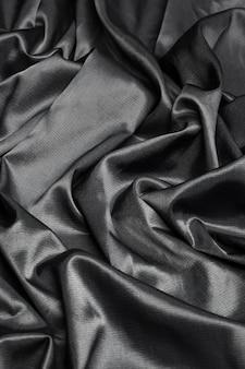 Superfície de tecido de seda preto