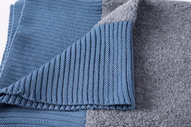 Superfície de textura de lã de tricô branca. fechar-se.