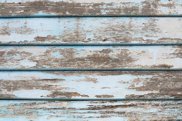 Superfície de textura de pedaços de madeira velha e abrasões de cor azul claro por natureza