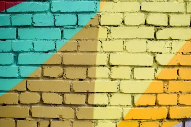 Superfície de tijolo multicolorido, pintado em cores diferentes. textura de fundo criativo.