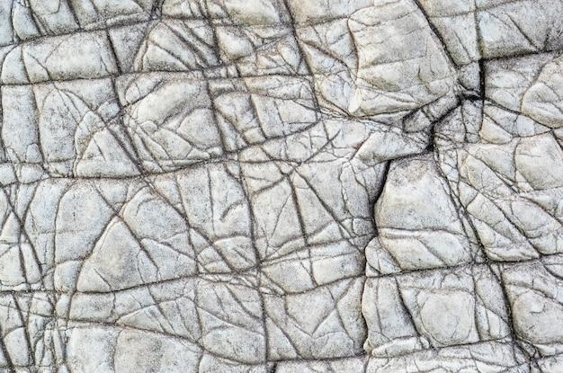Superfície do close up da rocha grande velha para a decoração no fundo da textura do jardim