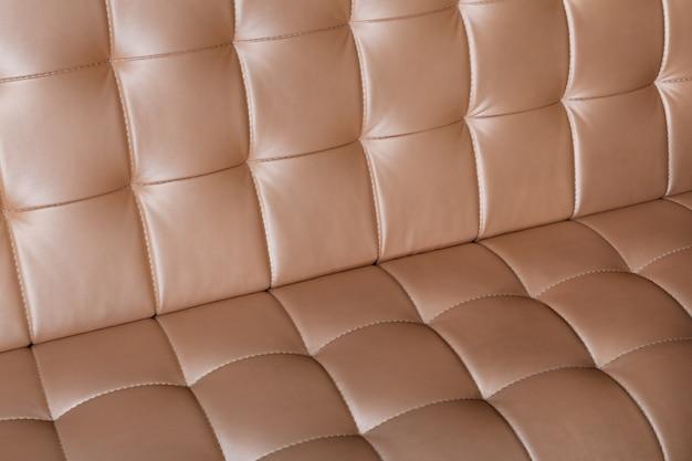 Superfície do close up do sofá de couro luxuoso