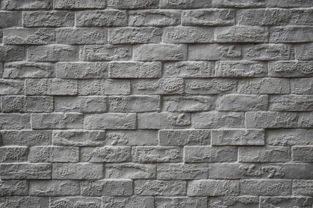 Superfície do fundo da parede de tijolos vintage